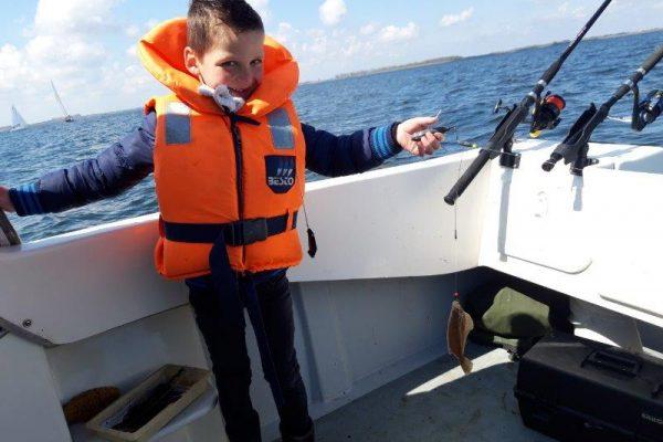 Tom, bootvissen op de Oosterschelde